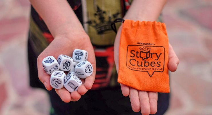 Rory's story cubes review- photo of Rory's story cubes and the carrying back in a child's hands.