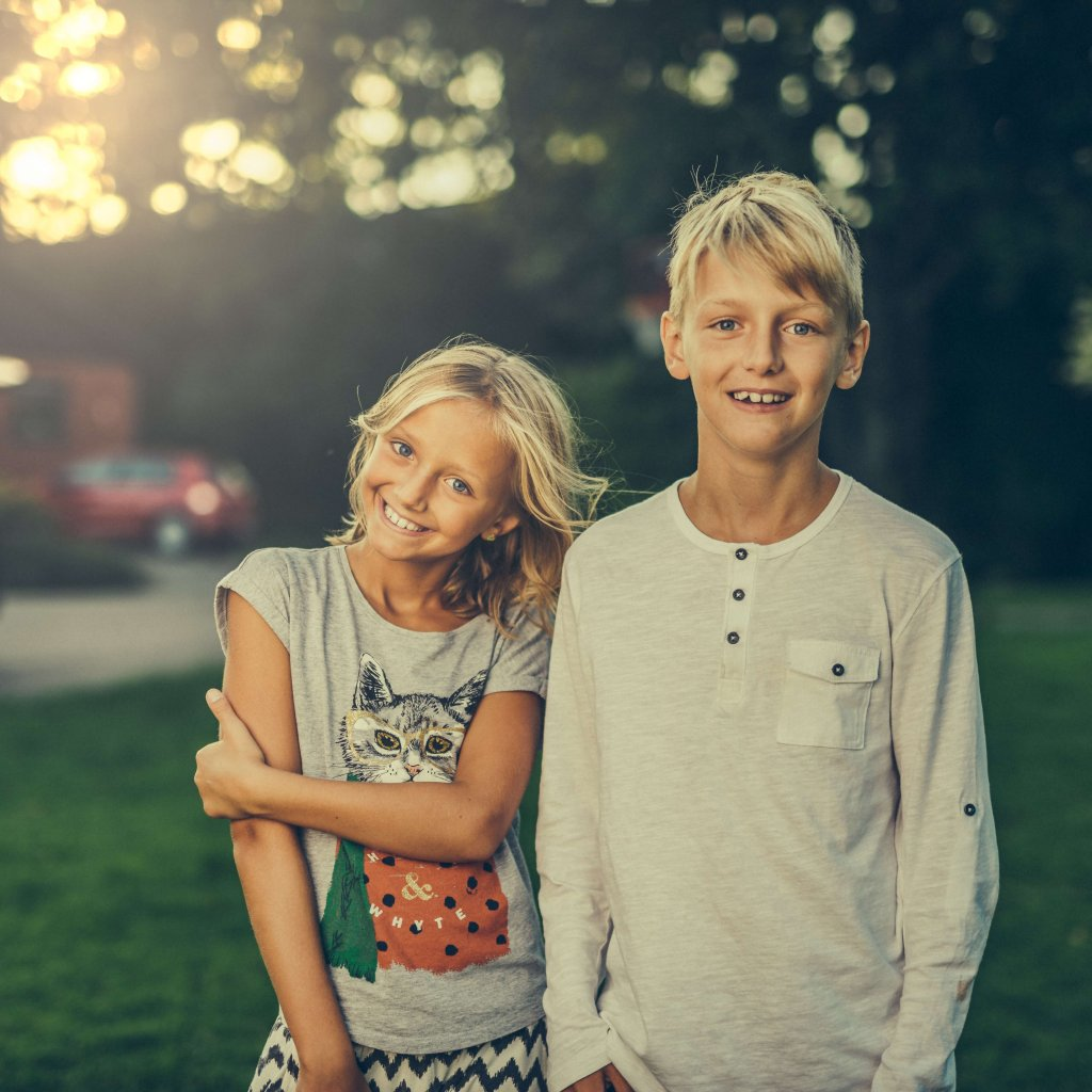 Family conversation starters! A photo of 2 blond kids smiling.