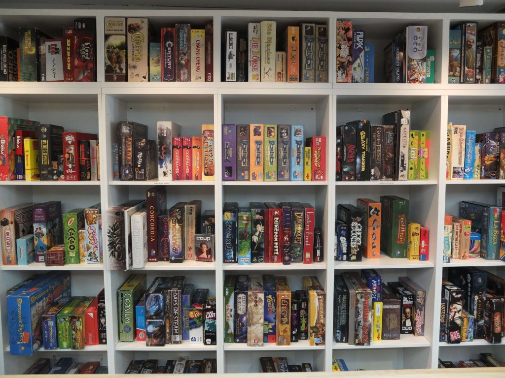 Board game library at a board game cafe- One of the best ways to connect with kids